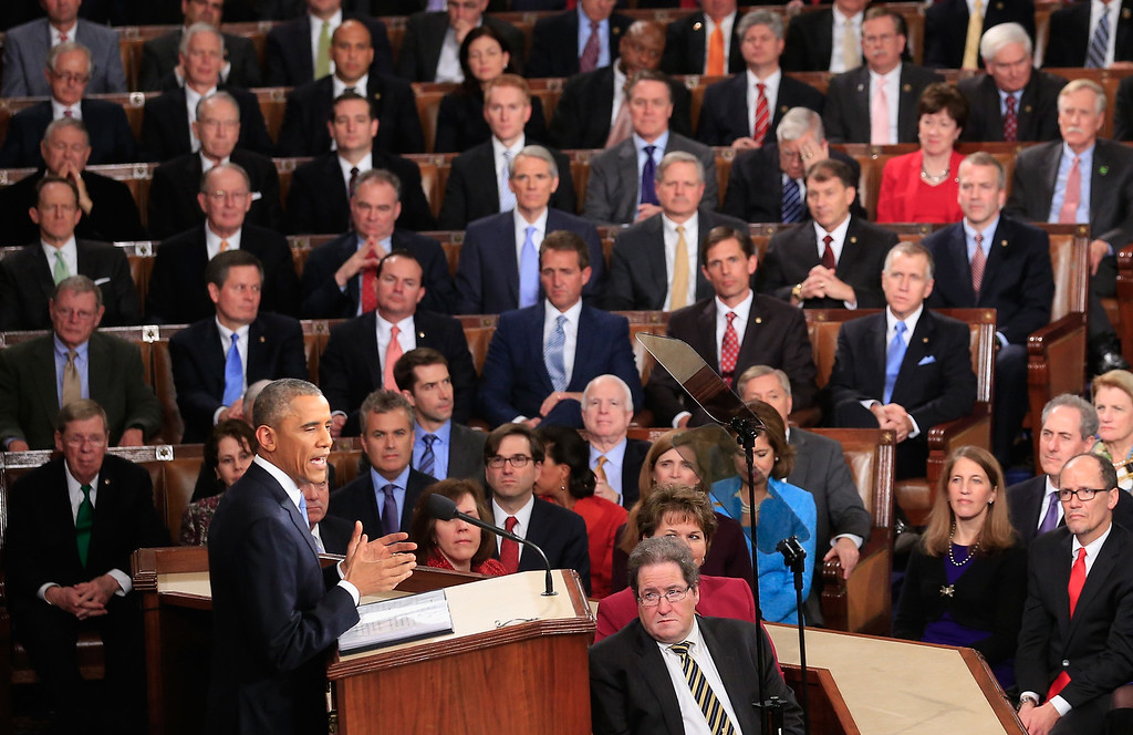 . WASHINGTON, DC - JANUARY 20:  U.S. President Barack Obama delivers his State of the Union speech before members of Congress in the House chamber of the U.S. Capitol January 20, 2015 in Washington, DC. Obama was expected to lay out a broad agenda to including attempts to address income inequality and making it easier for Americans to afford college education and child care.  (Photo by Rob Carr/Getty Images)