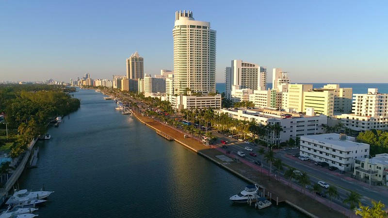 Aerial ascent reveal iconic Miami Beach hotels and condominiums 4k 60p