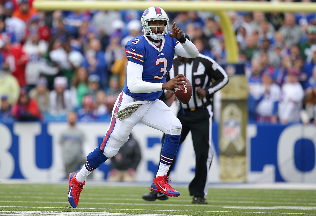 . E.J. Manuel #3 of the Buffalo Bills scrambles during NFL game action against the New York Jets at Ralph Wilson Stadium on November 17, 2013 in Orchard Park, New York. (Photo by Tom Szczerbowski/Getty Images)