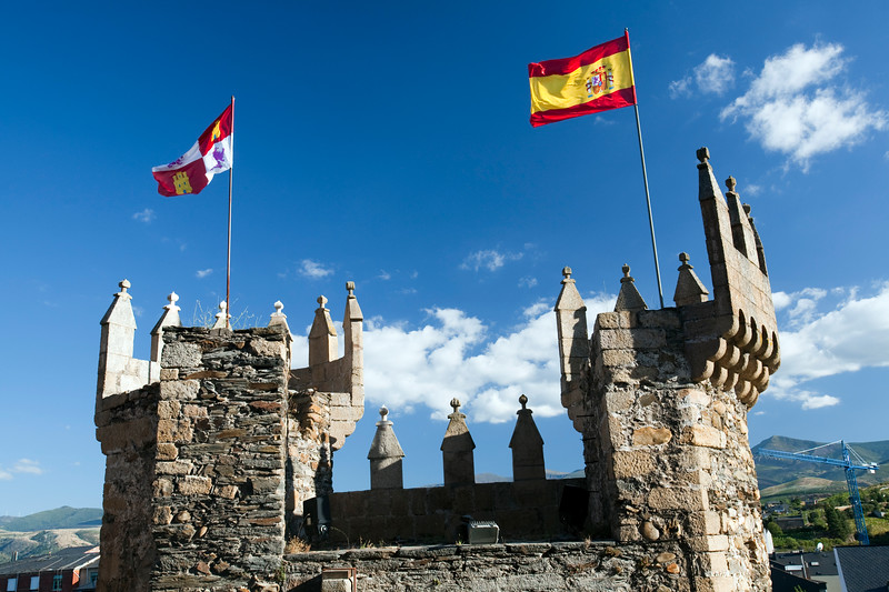 The flags of Spain and Castilla and Leon waving on the Templar castle, town of Ponferrada, El Bierzo region, province of Leon, autonomous community of Castilla and Leon, northern Spain