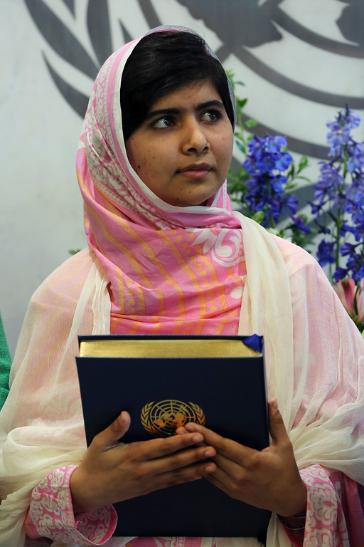. In this file photo dated Friday, July 12, 201,  Malala Yousafzai holds a copy of the United Nations charter presented to her by Secretary-General Ban Ki-moon, at United Nations headquarters.    (AP Photo/Mary Altaffer)