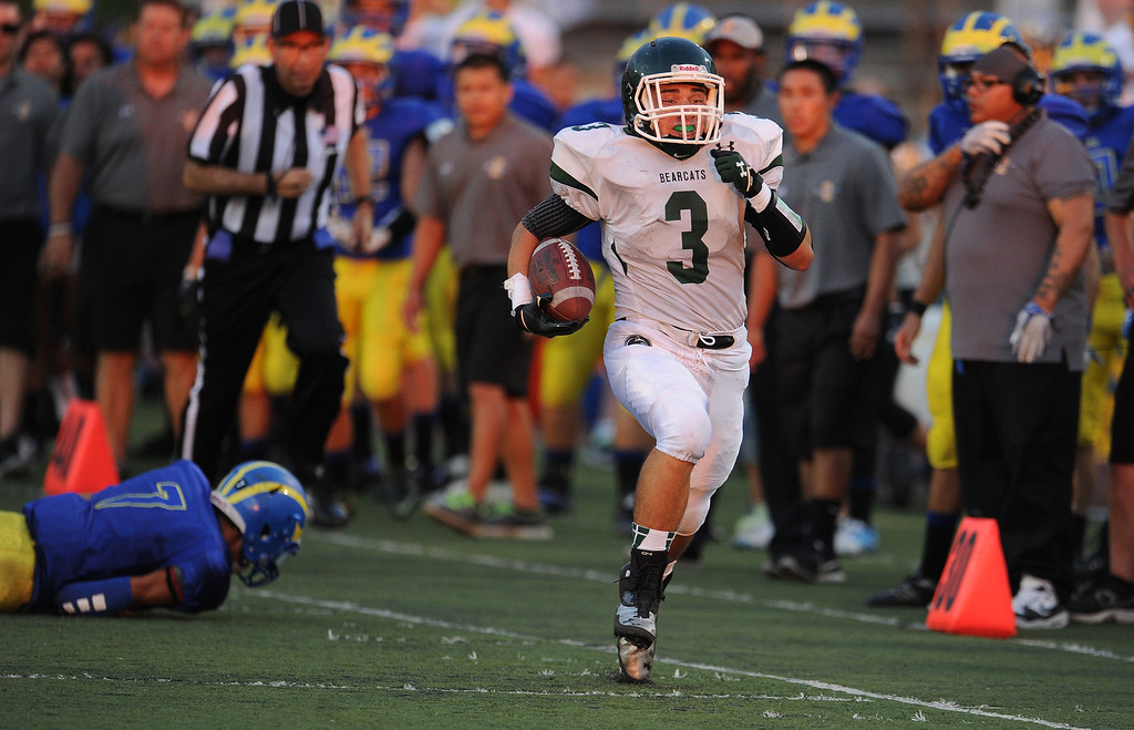 . Bonita\'s Thomas Loy (C) (3) runs a fumble back for a touchdown in the first half of a prep football game at Citrus College on Thursday, Aug. 29, 2013 in Glendora, Calif.   (Keith Birmingham/Pasadena Star-News)