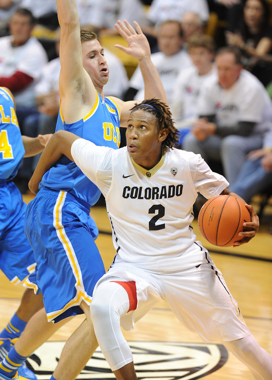 . Xavier Johnson gets past  a UCLA defender during the second half of the January 16, 2014 game in Boulder.  (Cliff Grassmick/Daily Camera)