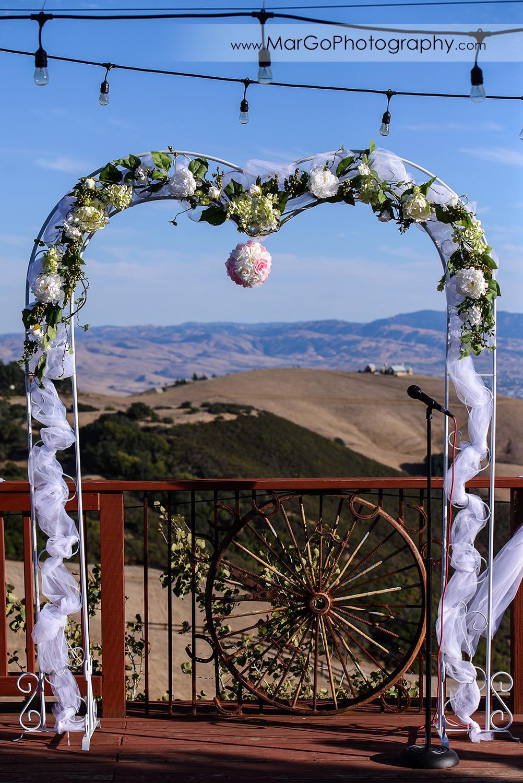 white flower arch for wedding ceremony