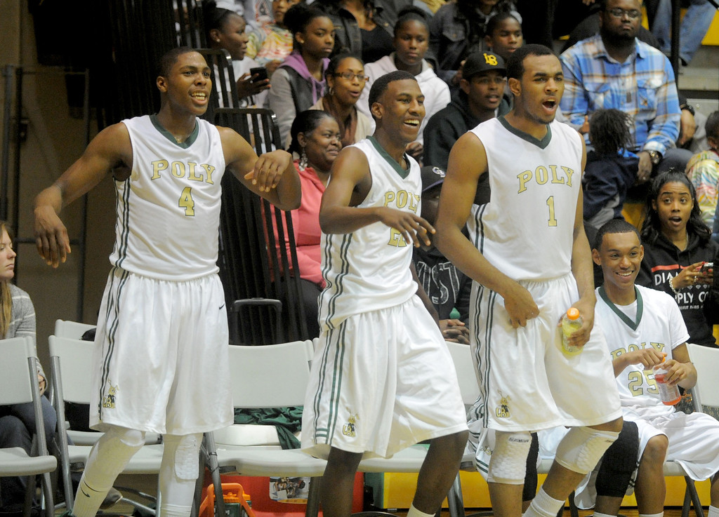 . 02-19-2012--(LANG Staff Photo by Sean Hiller)-Poly defeated Mayfair 73-28 in the second round of the Division I-AA boys basketball playoffs Tuesday night. Poly\'s Chris Sullivan (4), left, Brandon Staton (21) and Roschon Prince (1) are all smiles as the clock runs out.