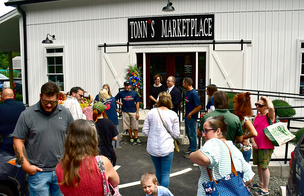 9/5/2019 Mike Orazzi   StaffrThe ribbon officially opening Tonns Marketplace on the Bristol Burlington line on Thursday afternoon.