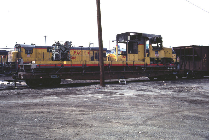 UP GP30 865. Wrecked in September 1983 and shown here in March 1984 in Salt Lake City on a flat car awaiting sale for scrap. (Don Strack Photo)