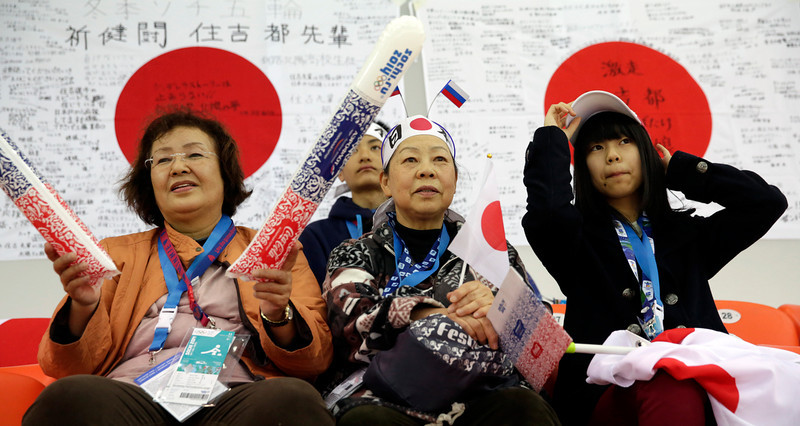 . Japanese skating fan wait for the start of the women\'s 500-meter speed skating race at the Adler Arena Skating Center at the 2014 Winter Olympics, Tuesday, Feb. 11, 2014, in Sochi, Russia. (AP Photo/Matt Dunham)