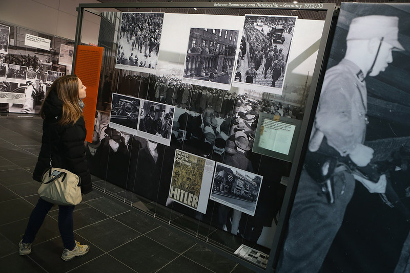 ". A visitor looks at one of exhibits at the exhibition ""Berlin 1933 - The Path To Dictatorship\"" at the Topography of Terror documentation center and museum on January 29, 2013 in Berlin, Germany. The exhibition, which opens officially tomorrow, examines the period in 1933 shortly after Adolf Hitler assumed power and the Nazis began murdering and intimidating political opponents as well as persecuting Jews. 2013 marks the 80th anniversary of the Nazi assumption of power.  (Photo by Sean Gallup/Getty Images)"
