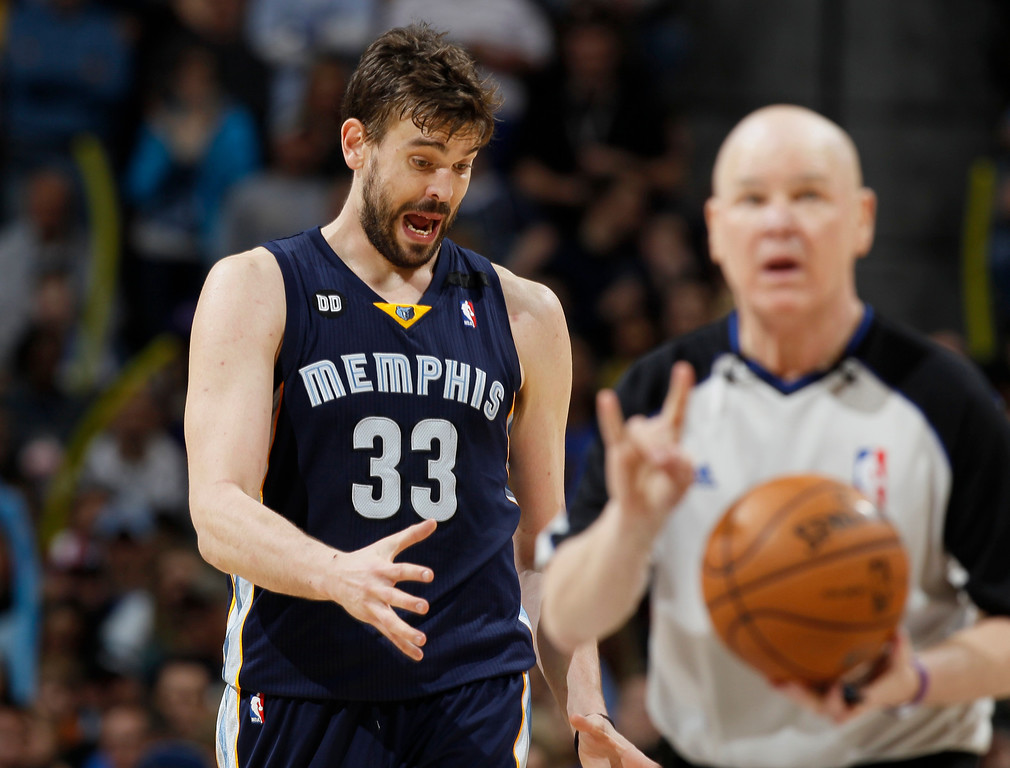 . Memphis Grizzlies center Marc Gasol argues with referee Joey Crawford after he was called for a foul in the fourth quarter of the Denver Nuggets\' 87-80 victory in an NBA basketball game in Denver on Friday, March 15, 2013. (AP Photo/David Zalubowski)
