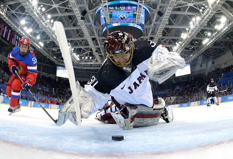 . Nana Fujimoto #30 of Japan makes a save  against Russia during the Women\'s Ice Hockey Preliminary Round Group B game on day four of the Sochi 2014 Winter Olympics at Shayba Arena on February 11, 2014 in Sochi, Russia.  (Photo by Mark Blinch - Pool/Getty Images)
