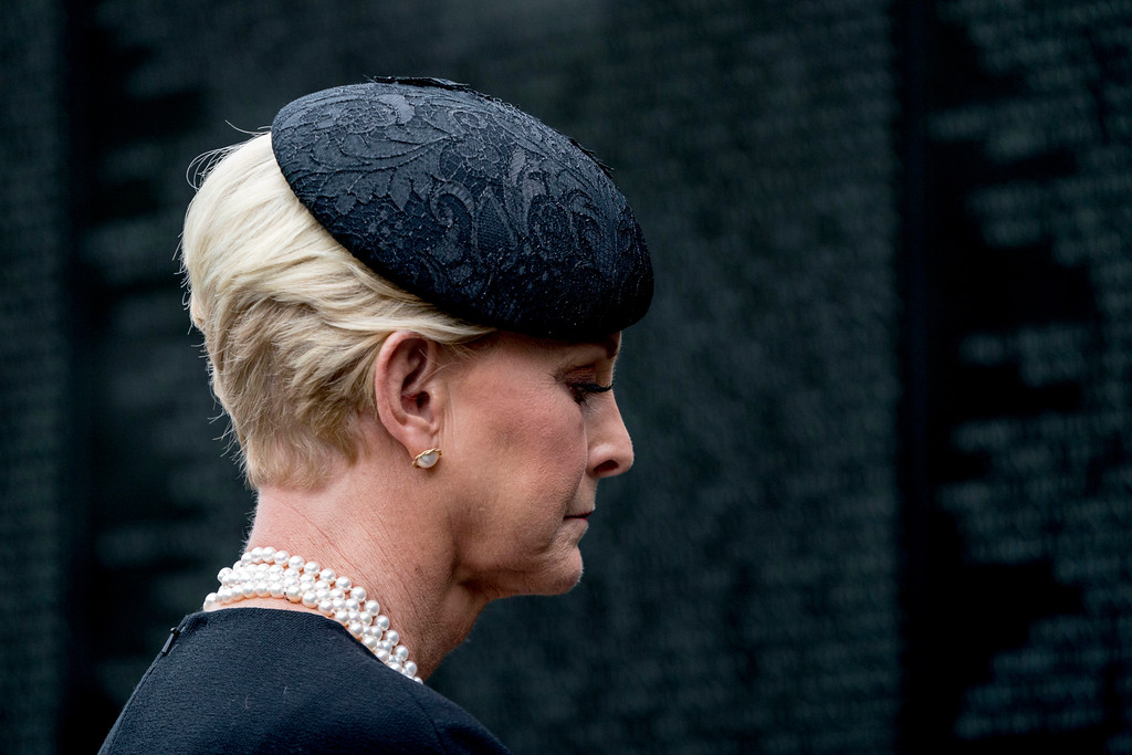 . Cindy McCain, wife of Sen. John McCain, R-Ariz., lays a wreath at the Vietnam Veterans Memorial in Washington, Saturday, Sept. 1, 2018, during a funeral procession to carry the casket of her husband from the U.S. Capitol to National Cathedral for a Memorial Service. McCain served as a Navy pilot during the Vietnam War and was a prisoner of war for more than five years. (AP Photo/Andrew Harnik, Pool)