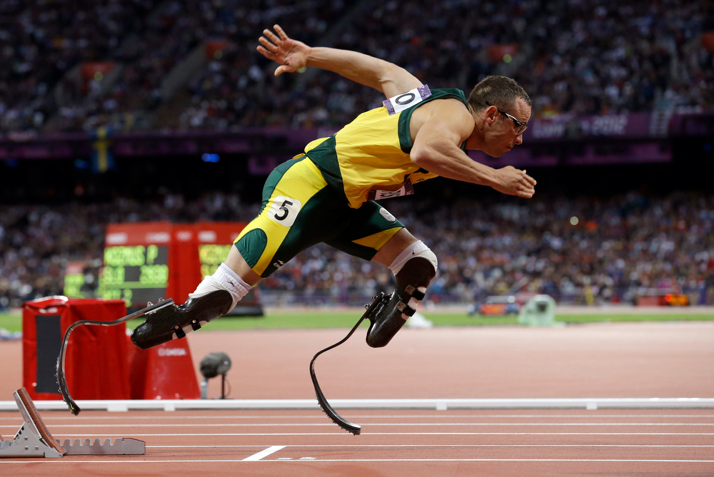 Description of . In this Aug.  5, 2012 file photo, South Africa\'s Oscar Pistorius starts in the men\'s 400-meter semifinal during the athletics in the Olympic Stadium at the 2012 Summer Olympics in London. Paralympic superstar Oscar Pistorius was charged Thursday, Feb. 14, 2013, with the murder of his girlfriend who was shot inside his home in South Africa, a stunning development in the life of a national hero known as the Blade Runner for his high-tech artificial legs.  Reeva Steenkamp, a model who spoke out on Twitter against rape and abuse of women, was shot four times in the predawn hours in the home, in a gated community in the capital, Pretoria, police said. (AP Photo/Anja Niedringhaus, File)