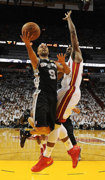 . Miami Heat center Joel Anthony (50) defends against San Antonio Spurs point guard Tony Parker (9) during the first half of Game 1 of basketball\'s NBA Finals, Thursday, June 6, 2013 in Miami. (AP Photo/Steve Mitchell, Pool)