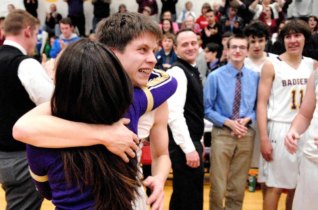 . Jeff Forman/JForman@News-Herald.com A cheerleader hugs Luke after  he sunk a shot in the fourth quarter.