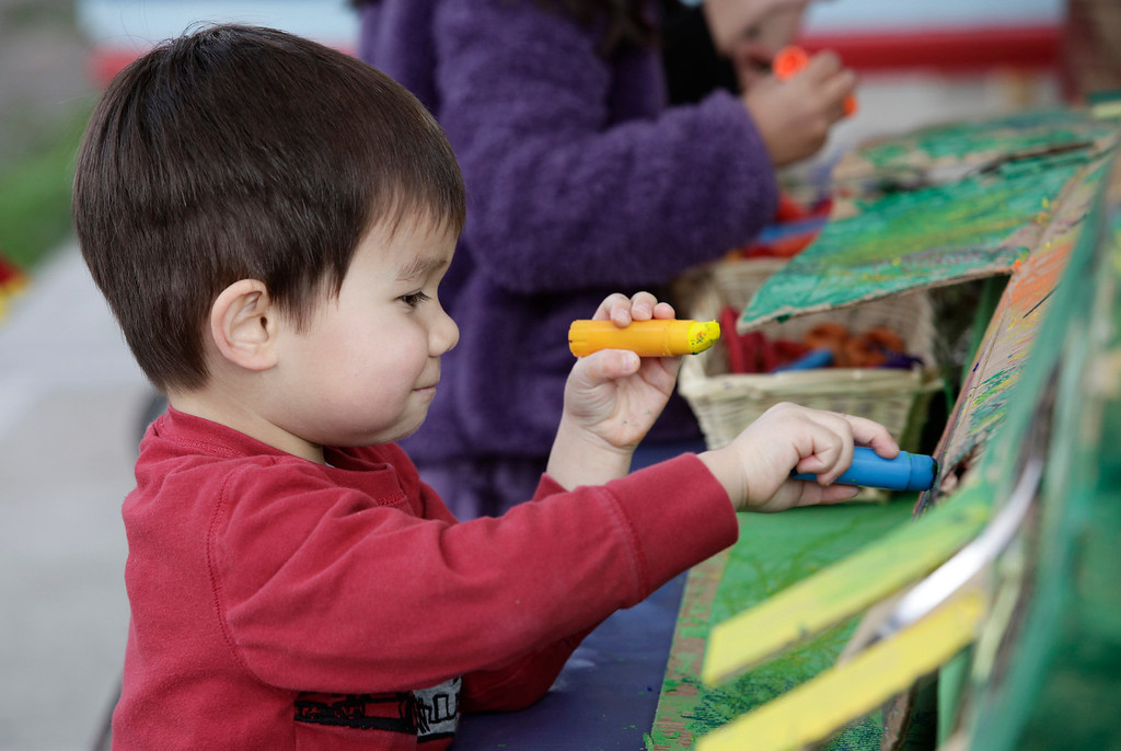 . Benjamin Hansen, 4, helps color a dragon to celebrate Lunar New Year at the Mountain View Parent Nursery School in Mountain View, Calif. on Friday, Feb. 8, 2013. The Mountain View-Whisman School District has decided that if parents hold back an eligible child from kindergarten, it will help evaluate those children for kindergarten-readiness the following year. Some will be sent to first grade rather than kindergarten. (Gary Reyes/ Staff)