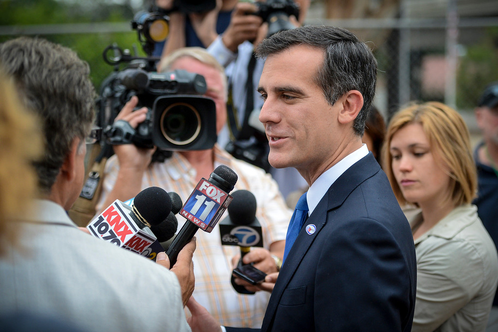 . Mayoral candidate Eric Garcetti talks with the media after voting at Allesandro Elementary school in Los Angeles early Tuesday morning.  Los Angeles residents will vote for a new mayor, Garcetti or Wendy Gruel in the citywide election.  Photo by David Crane/Staff Photographer