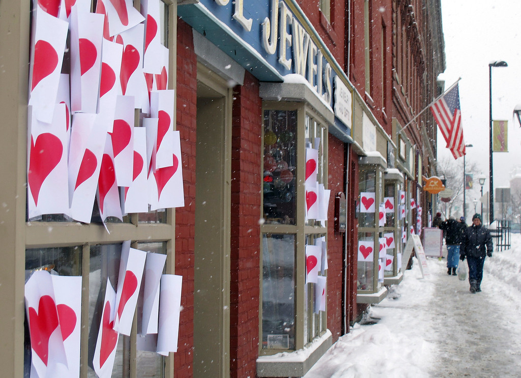 . Some of the hundreds of Valentine hearts are affixed to windows amid snowfall in downtown Montpelier, Vt., Friday, Feb. 14, 2014. The so-called Valentine\'s Bandit started the Montpelier tradition in in 2002. Many in Vermont were digging out Friday after a snowstorm dumped more than a foot of snow in some areas. (AP Photo/Wilson Ring)