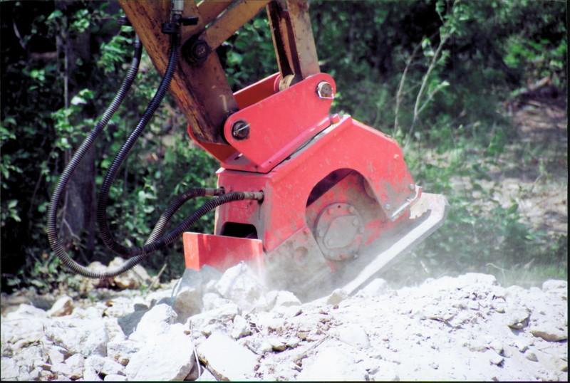 NPK C6C compactor with backfill blade on Deere excavator at NPKCE (3).JPG
