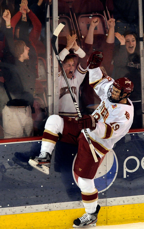 . Denver wing Daniel Doremus (19) celebrated a goal late in the first period. The University of Denver hockey team hosted Cornell at Magness Arena Saturday night, January 5, 2013. Karl Gehring/The Denver Post