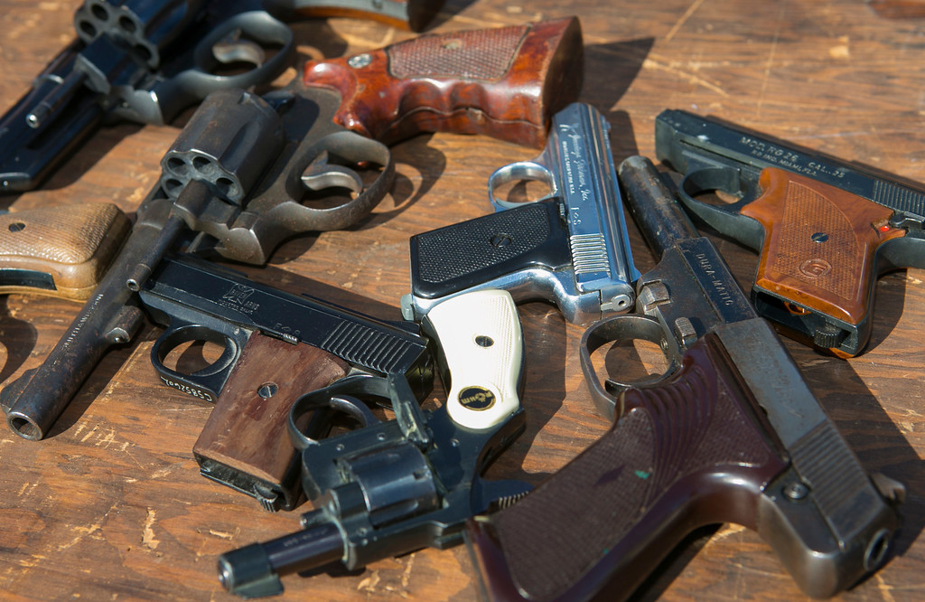 . Some of the hand guns that were turned in during the gun buyback. (John Green/Staff)
