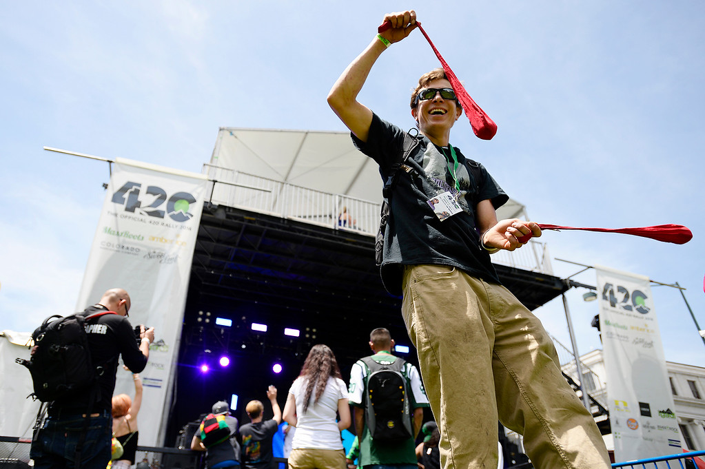 . James Jernigan swings his poi in front of the main stage during the Denver 420 Rally held Saturday at Civic Center Park. (Photo by Kira Horvath/ The Denver Post)