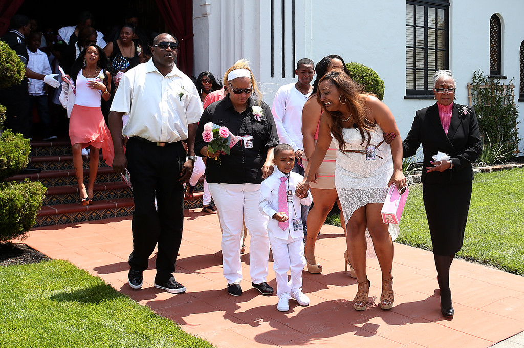 . Chiquita Carradine, second from right,  exits the McNary-Williams-Jackson Mortuary after funeral services for her daughter Alaysha Carradine ,8, on Tuesday, July 30, 2013 in Oakland, Calif.  Alaysha Carradine was shot and killed during a sleepover at a friends house in the 3400 block of Wilson Avenue earlier this month in Oakland.   (Aric Crabb/Bay Area News Group)