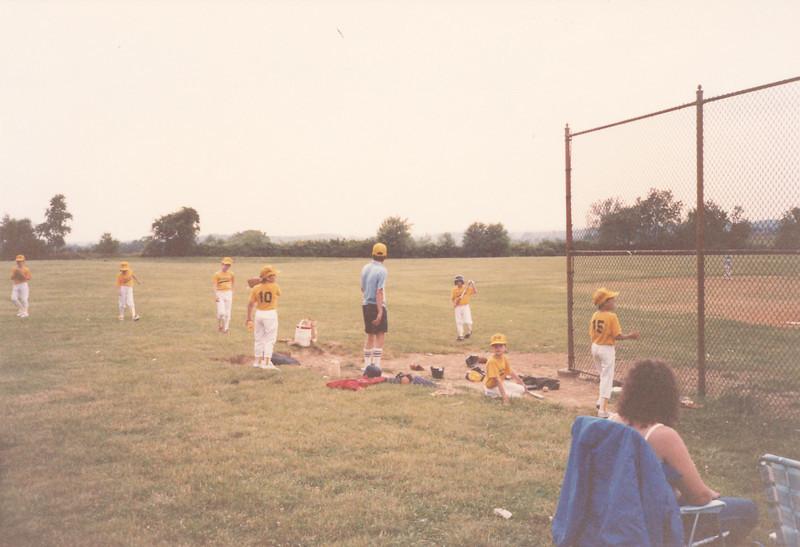All three boys at a Little League game