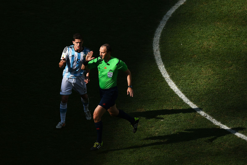 . Fernando Gago of Argentina appeals to referee Jonas Eriksson during the 2014 FIFA World Cup Brazil Round of 16 match between Argentina and Switzerland at Arena de Sao Paulo on July 1, 2014 in Sao Paulo, Brazil.  (Photo by Matthias Hangst/Getty Images)