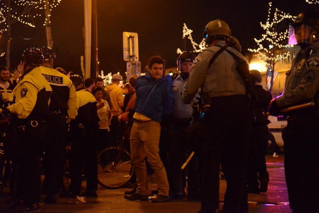 . Police detain one young man Saturday night in Dinkytown. (Pioneer Press: C.J. Sinner)
