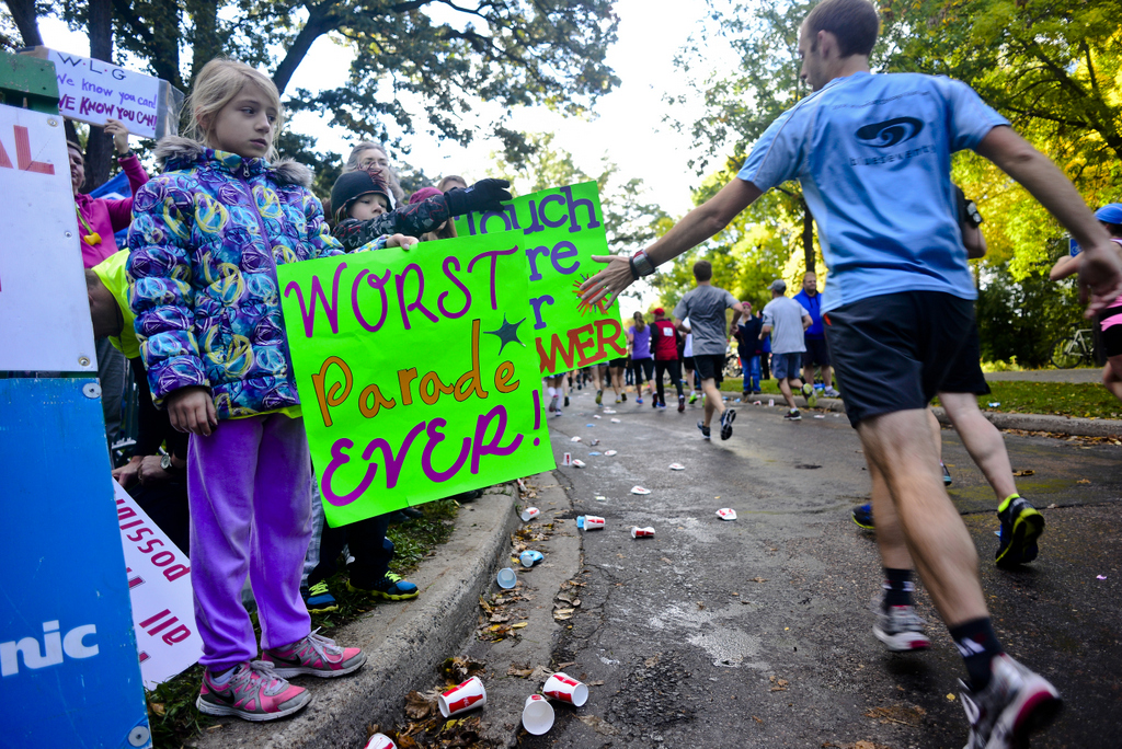 . McKenna Manthey of Marshall, Minn. shares her sentiments with runners nearing the Franklin Avenue Bridge in Minneapolis during the marathon. (Pioneer Press: Simon Guerra)