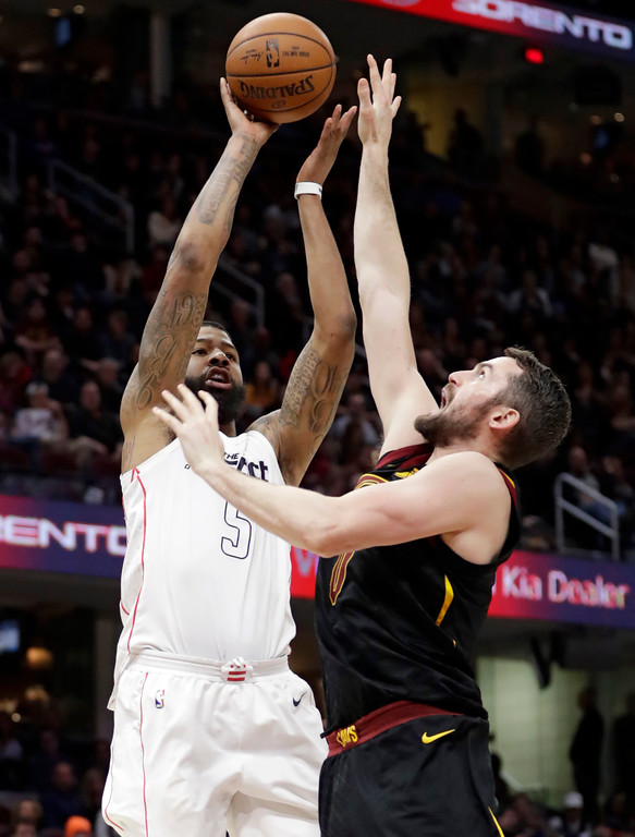 . Washington Wizards\' Markieff Morris (5) shoots over Cleveland Cavaliers\' Kevin Love (0) in the second half of an NBA basketball game, Thursday, April 5, 2018, in Cleveland. (AP Photo/Tony Dejak)
