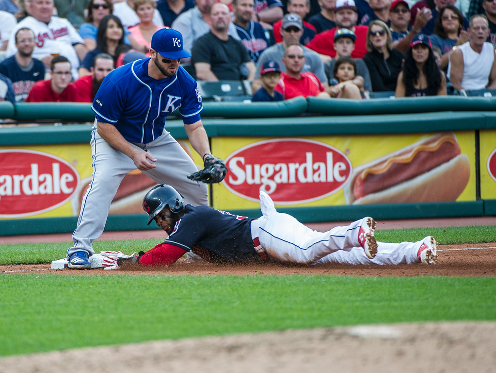 . Cleveland Indians\' Yandy Diaz is safe at third base as Kansas City Royals\' Mike Moustakas covers during the sixth inning of a baseball game in Cleveland, Saturday, Sept. 16, 2017. (AP Photo/Phil Long)