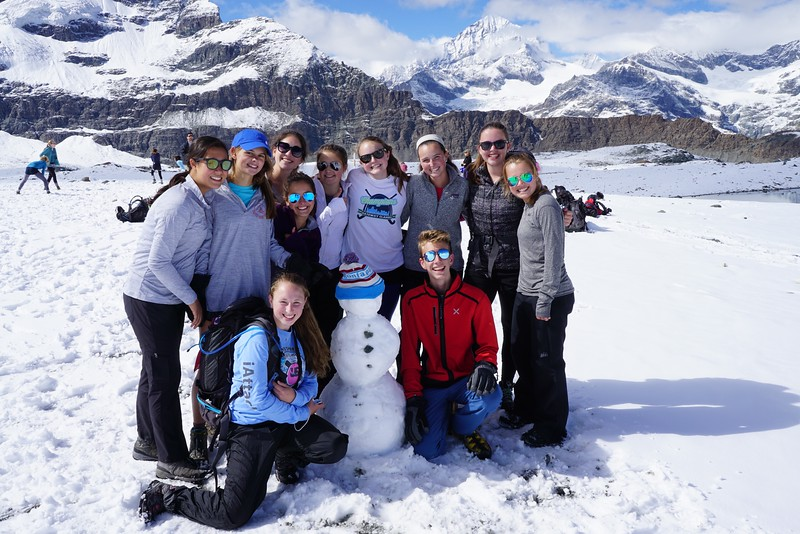 Mia, Shea, Ellie, Claire, Bella, Paige, Caroline, Peyton, Dylan, Hannah, and Penelope with their snowperson