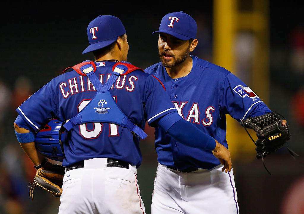 . ARLINGTON, TX - MAY 08:  Robinson Chirinos #61 of the Texas Rangers celebrates with closing pitcher Joakim Soria #28 of the Texas Rangers after the Rangers beat the Colorado Rockies 5-0 at Globe Life Park in Arlington on May 8, 2014 in Arlington, Texas.  (Photo by Tom Pennington/Getty Images)