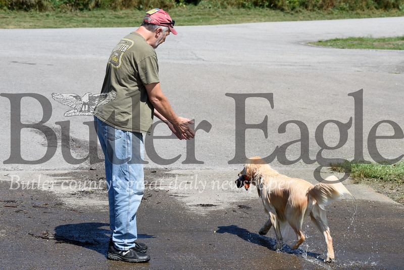 Harold Aughton/Butler Eagle: Randy and Jean Collins of Upper Burrell plan on spending the Labor Day weekend boating, fishing and playing with their 2-year-old Golden Retriever, Lilly.  According to Collins, Lilly loves chasing the floatable baton but doesn't like to return it.