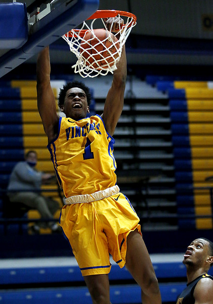 Photo by Matt Griffith/VU  Vincennes Univeristy's Randy Tucker gets a slam dunk against Triton Wednesday night in the P.E. Complex.