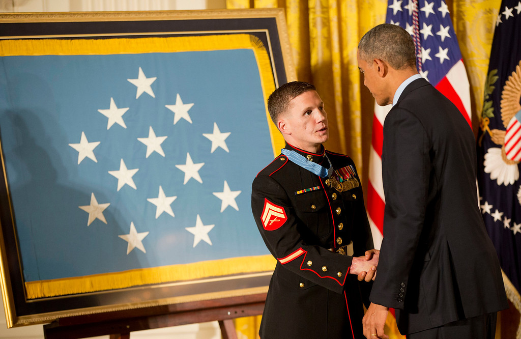 ". President Barack Obama shakes hands with retired Marine Cpl. William ""Kyle\"" Carpenter after awarding him the Medal of Honor, Thursday, June 19, 2014, in the East Room of the White House in Washington. (AP Photo/Pablo Martinez Monsivais)"