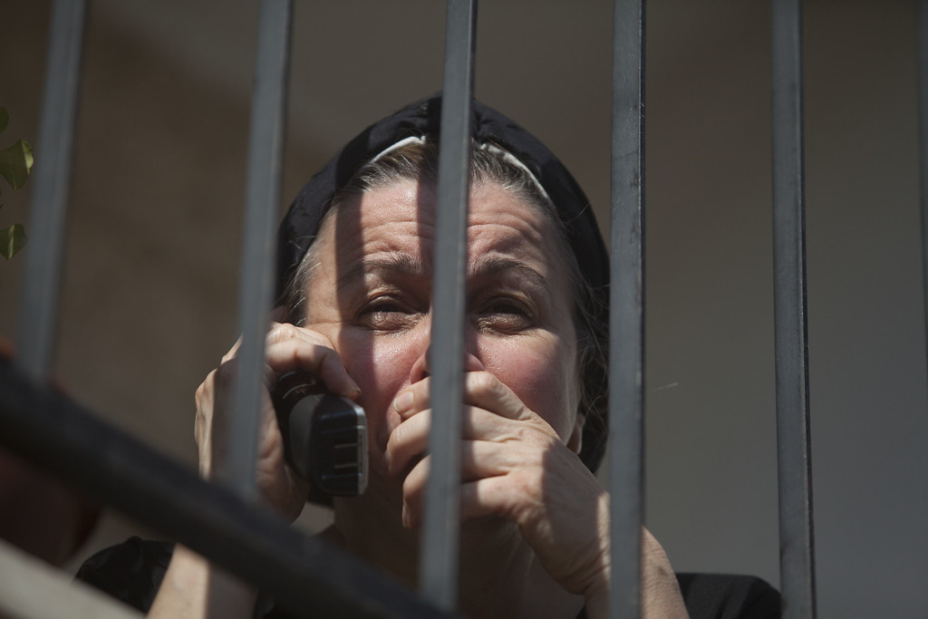 . An Israeli woman cries on a veranda next to a synagogue where a suspected Palestinian attack took place on November 18, 2014 in Jerusalem, Israel. Four Israelis have been killed and several others wounded in a terror attack this morning in a synagogue in the western Jerusalem neighborhood of Har Nof. Two Palestinian assailants were killed at the scene by police.  (Photo by Lior Mizrahi/Getty Images)