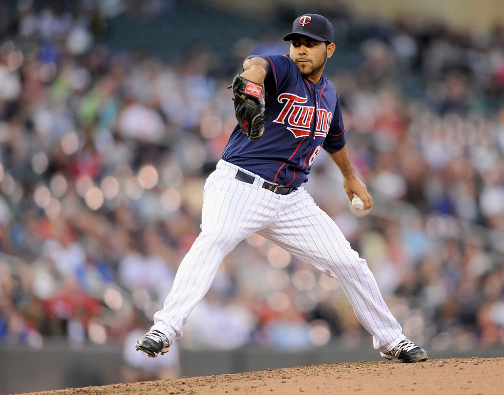 . MINNEAPOLIS, MN - MAY 13: Pedro Hernandez #60 of the Minnesota Twins delivers a pitch against the Chicago White Sox during the third inning of the game on May 13, 2013 at Target Field in Minneapolis, Minnesota. (Photo by Hannah Foslien/Getty Images)