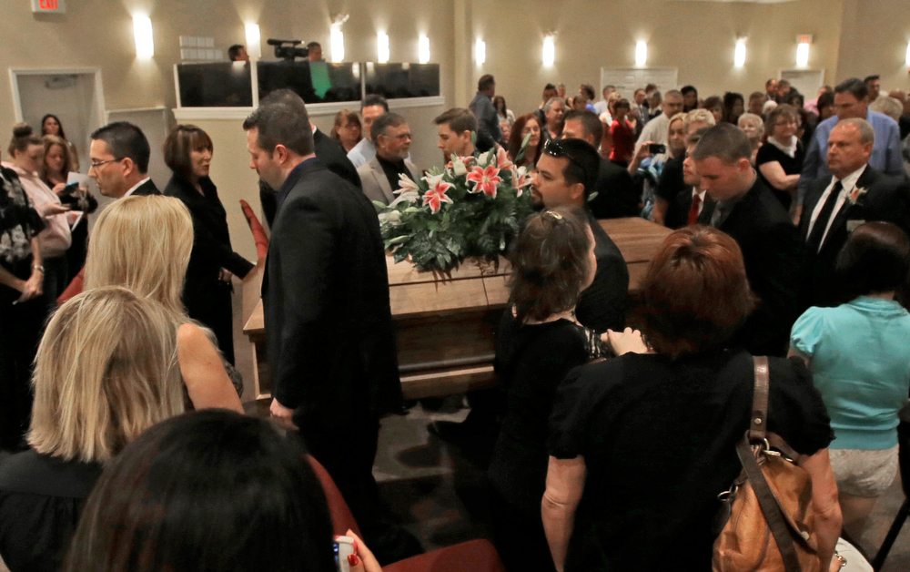 . Pall bearers carry the casket of country music star Mindy McCready after a funeral ceremony at the Crossroads Baptist Church in Fort Myers, Fla., Tuesday, Feb. 26, 2013.  McCready committed suicide Feb. 17 at her home in Arkansas, days after leaving a court-ordered substance abuse program. (AP Photo/Alan Diaz)