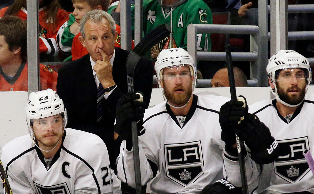 . Los Angeles Kings head coach Darryl Sutter watches during the first period in Game 7 of the Western Conference finals in the NHL hockey Stanley Cup playoffs against the Chicago Blackhawks Sunday, June 1, 2014, in Chicago. (AP Photo/Nam Y. Huh)