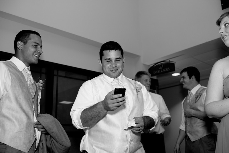 Checking out Nick's toast that he has written on his phone.