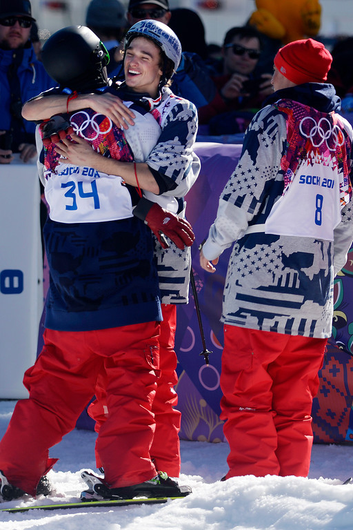 . U.S.A. skier Nick Goepper hugs teammate Joss Christensen as teammate Gus Kenworthy looks on after the trio swept the podium during the men\'s ski slopestyle final at the Rosa Khutor Extreme Park. Sochi 2014 Winter Olympics on Thursday, February 13, 2014. (Photo by AAron Ontiveroz/The Denver Post)