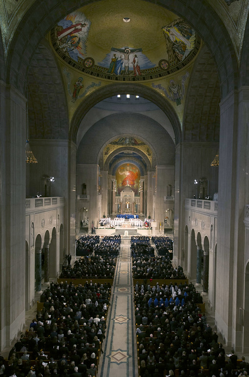 . People look on during the funeral Mass for Associate Justice Antonin Scalia at the Basilica of the National Shrine of the Immaculate Conception February 20, 2016 in Washington, DC.  Scalia, who died February 13 while on a hunting trip in Texas, laid in repose in the Great Hall of the Supreme Court on Friday and his funeral service will be at the basillica today.   (Photo by  Doug Mills-Pool/Getty Images)