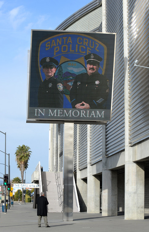 . The outside of the HP Pavilion in San Jose, Calif., is prepared for the memorial service for two fallen Santa Cruz police detectives on Thursday, March 7, 2013. (Dan Honda/Bay Area News Group)