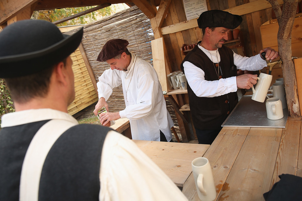 . Locals dressed in early-19th century regional period clothing serve beer and drinks in a recreated 1813 village in Liebertwolkwitz district during events to commemorate the 200th anniversary of The Battle of Nations on October 16, 2013 in Leipzig, Germany.  (Photo by Sean Gallup/Getty Images)