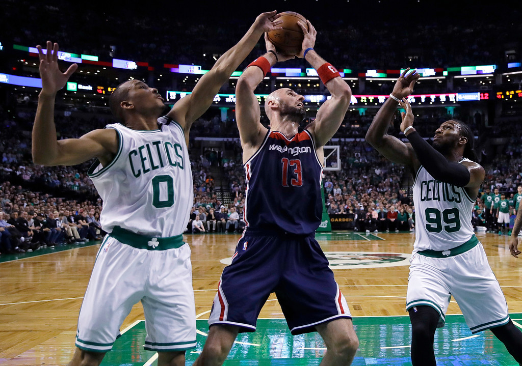 . Boston Celtics guard Avery Bradley (0) and forward Jae Crowder (99) pressure Washington Wizards center Marcin Gortat (13) during the second quarter of a second-round NBA playoff series basketball game in Boston, Tuesday, May 2, 2017. (AP Photo/Charles Krupa)