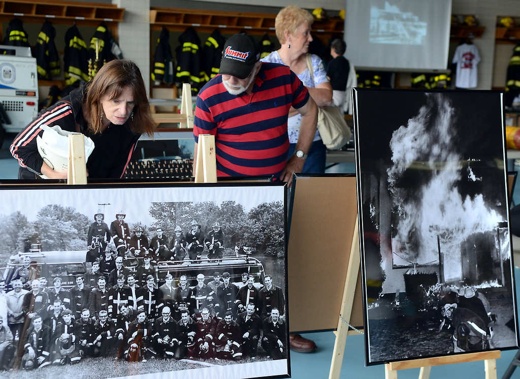 . Displays of old photos and fire equipment are inspected for the  Fairmount Fire Company 125th Anniversary festivities during the Lansdale Founders Day celebration on Saturday August 23,2014. Photo by Mark C Psoras/The Reporter