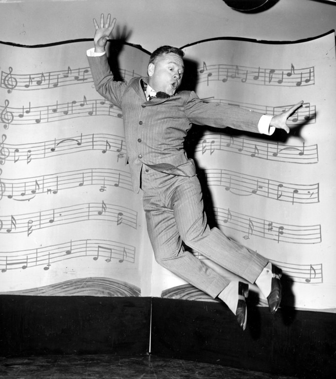 ". n this March 19, 1957, file photo, actor, singer and dancer Mickey Rooney, wearing spats and a pinstriped suit, performs a dance routine during rehearsal for the television show ""George M. Cohan Story\"" in Hollywood, Calif.  (AP Photo/File)"
